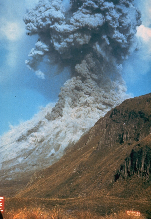 Pyroclastic flows traveling down the flanks of Ngauruhoe volcano on 19 February 1975 as an ash plume rises above the summit crater. The eruption column rose 12 km above the vent and ash fell 160 km away in Hamilton City. Explosive activity had begun on the 12th and continued until the 23rd. Photo by Graham Hancocks, 1975 (New Zealand Geological Survey).