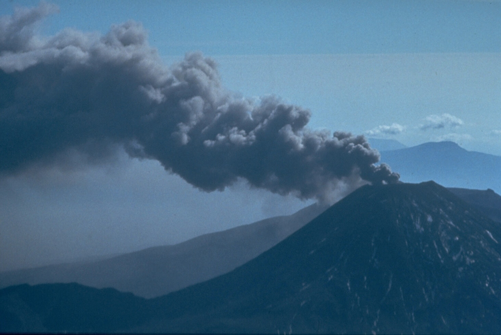 An ash plume on 29 March 1974, is directed by the wind from the summit of Ngauruhoe volcano one day after powerful explosions that were accompanied by pyroclastic flows. Intermittent explosive eruptions had been occurring since 22 November 1972 and continued until 19 August 1974. Eruptions in January and March 1974 were the largest in two decades from Ngauruhoe. Photo by Jim Cole, 1974 (University of Canterbury).