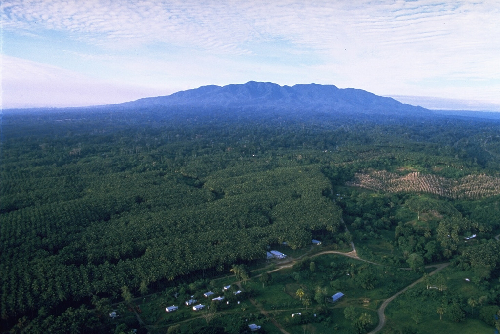 Mount Balbi is seen here from the village of Wakunai, E of the volcano along the NE coast of Bougainville Island. Balbi is the largest volcano on the island and has a NW-SE-trending chain of vents. Photo by Wally Johnson, 1987 (Australia Bureau of Mineral Resources).