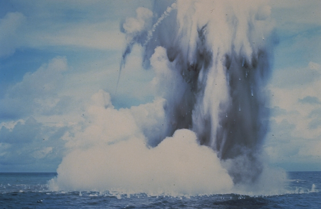 Submarine explosions from Kavachi volcano eject a cock's-tail plume of water, steam, and ash above the sea surface in July 1977. Large ejected blocks are visible falling from the plume and impacting the sea surface. Similar activity was observed over a period of less than a week. Photo by W.G. Muller, 1977 (courtesy of Deni Tuni, Ministry of Lands, Energy and Mineral Resources, Solomon Islands).
