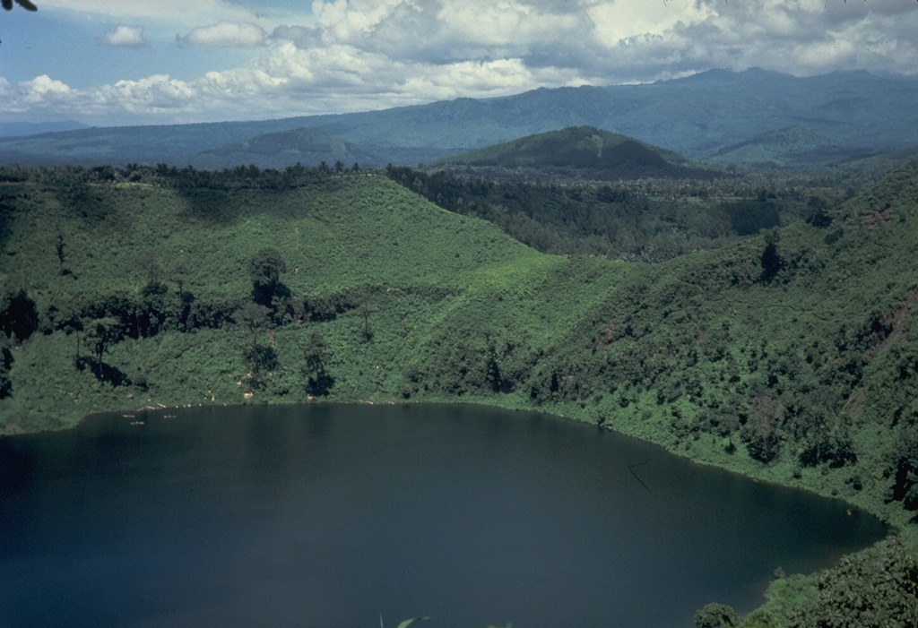 This lake-filled maar on the NE flank of Lamongan is one of 27 surrounding the volcano. Most historical eruptions have originated from the summit crater. Photo by Tom Casadevall, 1987(U.S. Geological Survey).