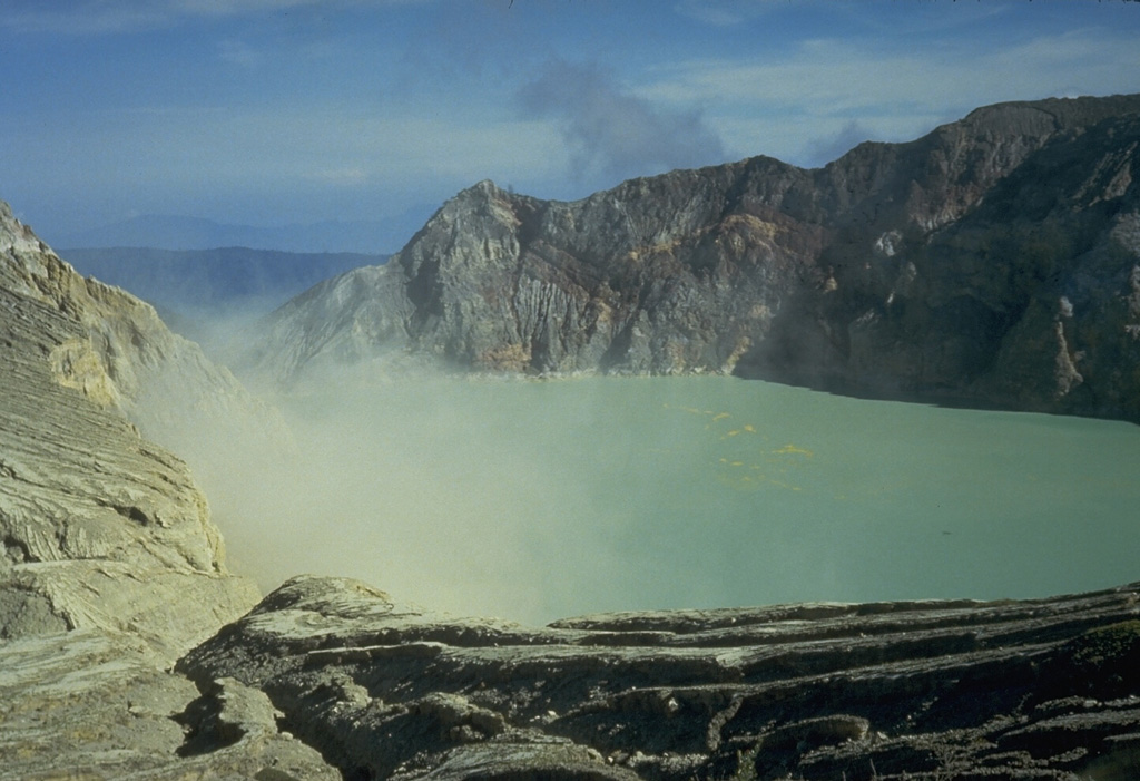 Active fumaroles on the SE crater wall of the highly acidic Kawah Ijen crater lake, within one of the cones that formed in the 20-km-wide Ijen caldera. The 1-km-wide turquoise-colored crater lake is near the eastern rim of Ijen caldera and has been the site of phreatic eruptions in historical time and is noted for its sulfur deposits.  Photo by Tom Casadevall, 1987 (U.S. Geological Survey).