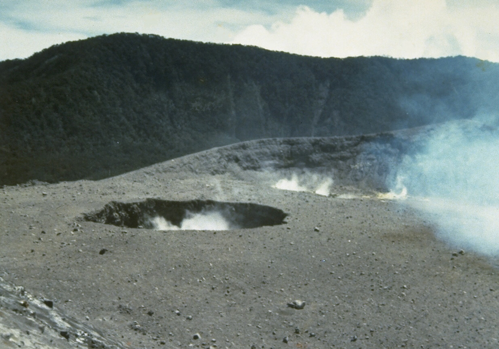 Plumes rise from two small craters near the center of Marapi's broad E-W-trending summit. The background ridge in the shadow is the eastern rim of a larger crater, Kebun Bungo. Photo by J. Mataheumual, 1978 (Volcanological Survey of Indonesia).