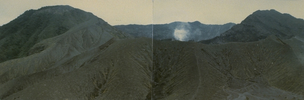A small plume rises from Kaba Kecil, the middle of three summit craters on Kaba volcano, viewed from the ENE at Vogelsang Peak on the upper NNE flank. The Bukit Biring peak is to the left of Kaba Kecil crater and Bukit Kaba peak is to the right. The far wall of Kaba Lama crater, the largest crater at Kaba, forms the center horizon. Photo by Deddy Rochendi, 1981 (Volcanological Survey of Indonesia).