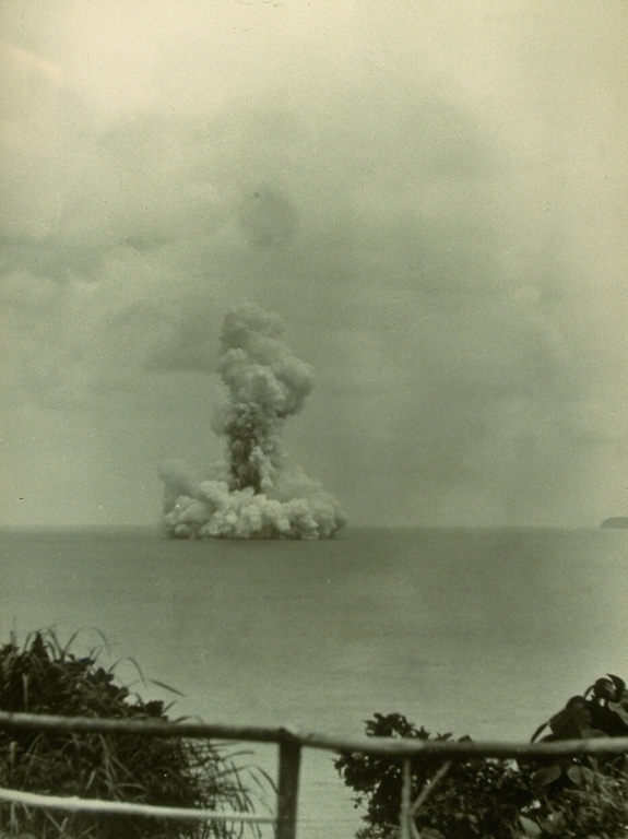 A submarine eruption from Anak Krakatau on 13 June 1930, produces both a vertical eruption plume and a base surge extending radially from the vent along the surface of the sea. Submarine eruptions were first observed in December 1927, forming several ephemeral islands. By 12 August 1930 Anak Krakatau had become a permanent island. Photo by W. Petroschevsky, 1930 (courtesy Volcanological Survey of Indonesia).