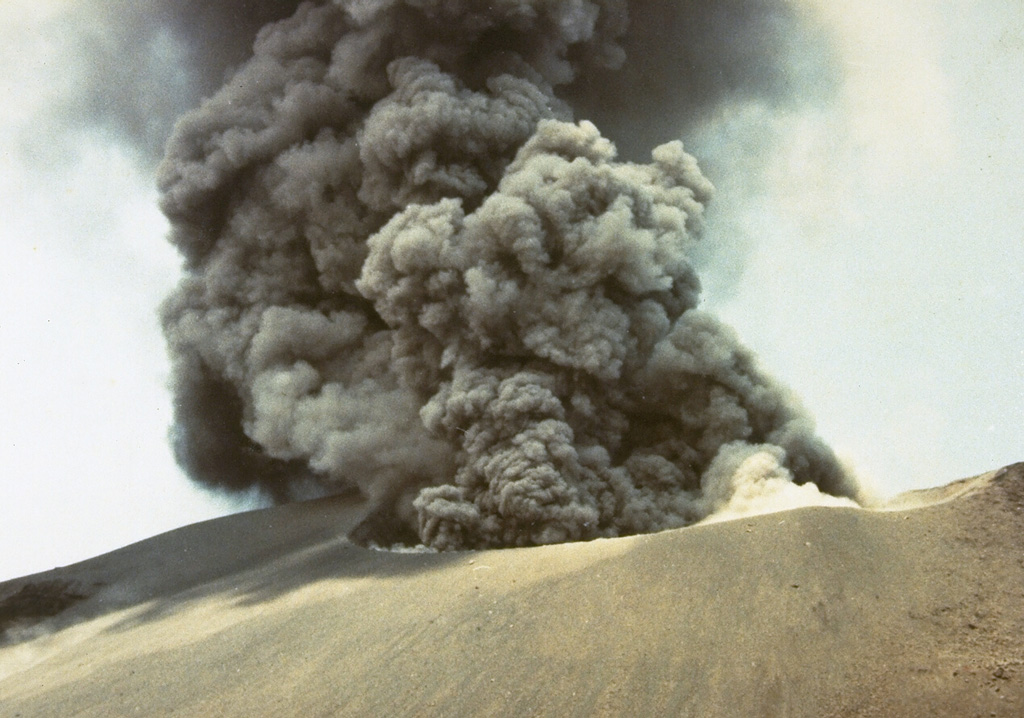 Explosive eruptions, such as this one in October 1978, occurred at Anak Krakatau from July to November. Initially, explosions occurred at intervals of 15-30 minutes, decreasing to intervals of 30-60 minutes in October before the eruption ended in November. Photo by J. Matahelumual, 1978 (Volcanological Survey of Indonesia).
