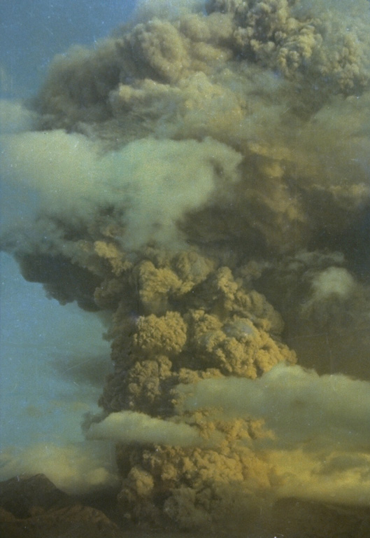 An ash plume rising above Galunggung in October 1982. Intermittent explosive eruptions had taken place since the start of the eruption on 5 April, accompanied by pyroclastic flows and lahars that devastated nearby areas. More than 40,000 people were evacuated during the eruption. Photo by Ruska Hadian, 1982 (Volcanological Survey of Indonesia).