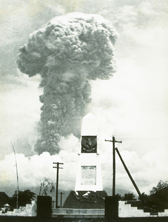 An ash plume towers above Bali's Agung volcano on 12 March 1963. Five days later a devastating eruption produced pyroclastic flows and lahars that killed 1,148 people. Another powerful eruption on 16 May caused additional fatalities. The eruption left tens of thousands homeless. Photo by K. Kusumadinata, 1963 (Volcanological Survey of Indonesia).