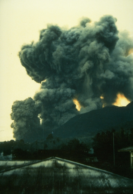 On May 9, 1988, ash columns rise from four eruptive vents along a fissure on the southern flank of Banda Api volcano, observed here from the village of Neira, located across a narrow strait 4.5 km east of the eruptive fissure.  An arcuate N-SSW-trending eruptive fissure cut almost entirely across Gunung Api Island during the first day of the eruption and produced both vigorous explosive activity and lava flows.  Winds distributed ashfall primarily to west, away from Neira Island. Photo by Willem Rohi, 1988 (Volcanological Survey of Indonesia).