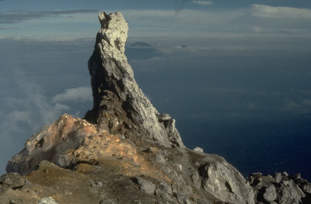 This 10-m-high remnant of a lava spine was at the summit of one of Merapi's older lava domes in 1989 and had collapsed by 2006. The slope to the left drops off steeply into Merapi's summit crater. Photo by Tom Pierson, 1989 (U.S. Geological Survey).
