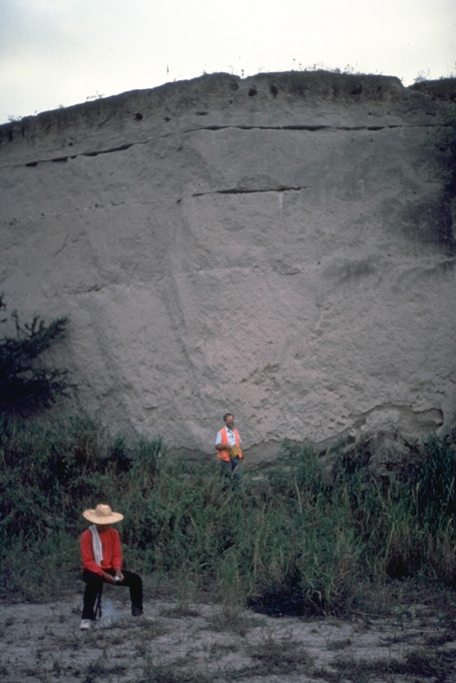 Geologists investigate a thick pyroclastic flow deposit on the ENE side of Parker volcano in southern Mindanao. Preliminary investigation of the eruptive deposits of this volcano revealed many similarities to those of Pinatubo. The flanks of both volcanoes are blanketed with thick pyroclastic flow deposits produced by powerful explosive eruptions. Photo courtesy Chris Newhall (U.S. Geological Survey).