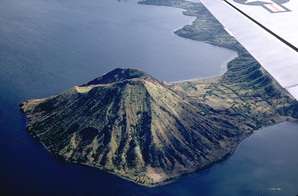 Binintiang Malaki, a cone at the NW tip of Volcano Island, formed during an eruption in 1707. The cone, seen here from the SW, is the largest of the flank cones on Volcano Island. Photo by Kurt Frederickson, 1968 (Smithsonian Institution).