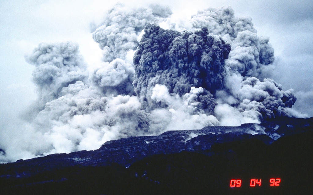 An ash plume rises several km above the west flank of Pinatubo volcano on 4 September 1992. This was not the result of an eruption, but of secondary explosions produced when water contacted still-hot pyroclastic flow deposits of the 1991 eruption. This can occur either when channel banks eroded into the deposits collapse into streams, or when groundwater invades hot deposits along buried stream channels. Ash columns as high as 18 km were produced by these events, and sometimes new pyroclastic flows were created. Photo by Chris Newhall, 1992 (U.S. Geological Survey).