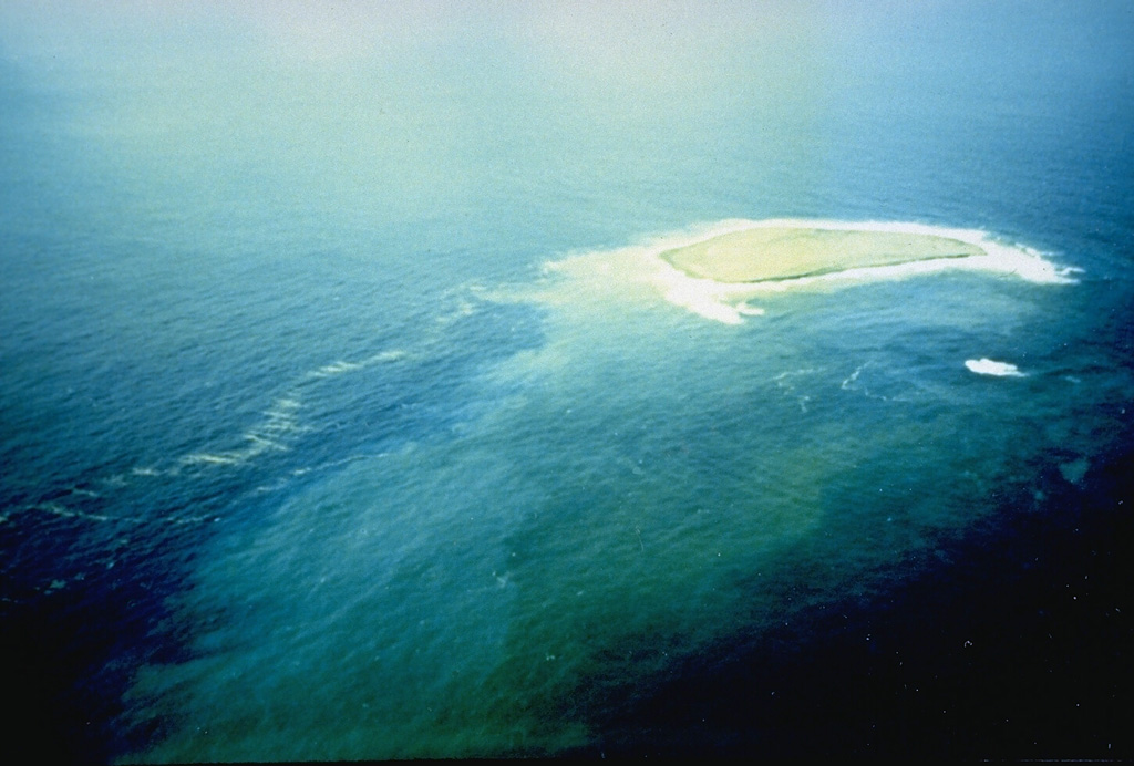 A new island at the Fukutoku-Okanoba submarine volcano on 28 January 1986. It was first seen on 20 January, four days after fishing boats first observed an eruption plume rising from the sea. The island reached a maximum size of 400 x 600 m, with a height of 15 m. By 22 January explosive activity had ceased, and the island was completely eroded away by the sea by 8 March. Photo by G. Iwashita, 1986 (Japan Meteorological Agency).