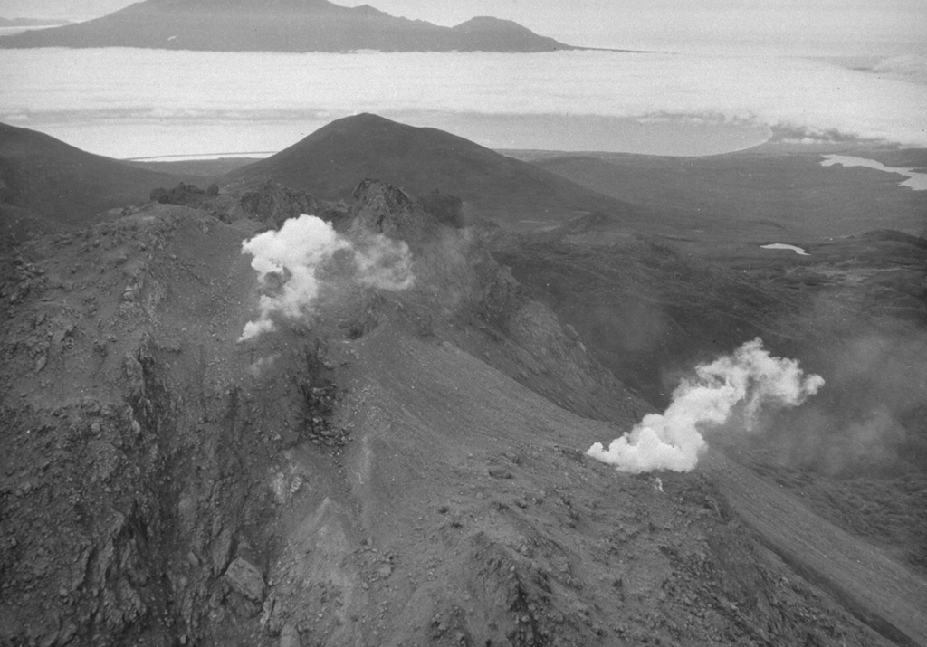 The Etorofu-Yakeyama (Ivan Grozny) volcano group in central Iturup Island contains the historically active Yakeyama (Grozny) andesitic lava dome and several other Holocene domes to the NE. This September 1989 view from the E shows fumarolic emissions that began at the time of a minor 1989 eruption on the N flank of the active dome. Photo by A. Samoluk, 1989 (courtesy of Genrich Steinberg, Institute for Marine Geology and Geophysics, Yuzhno-Sakhalinsk).