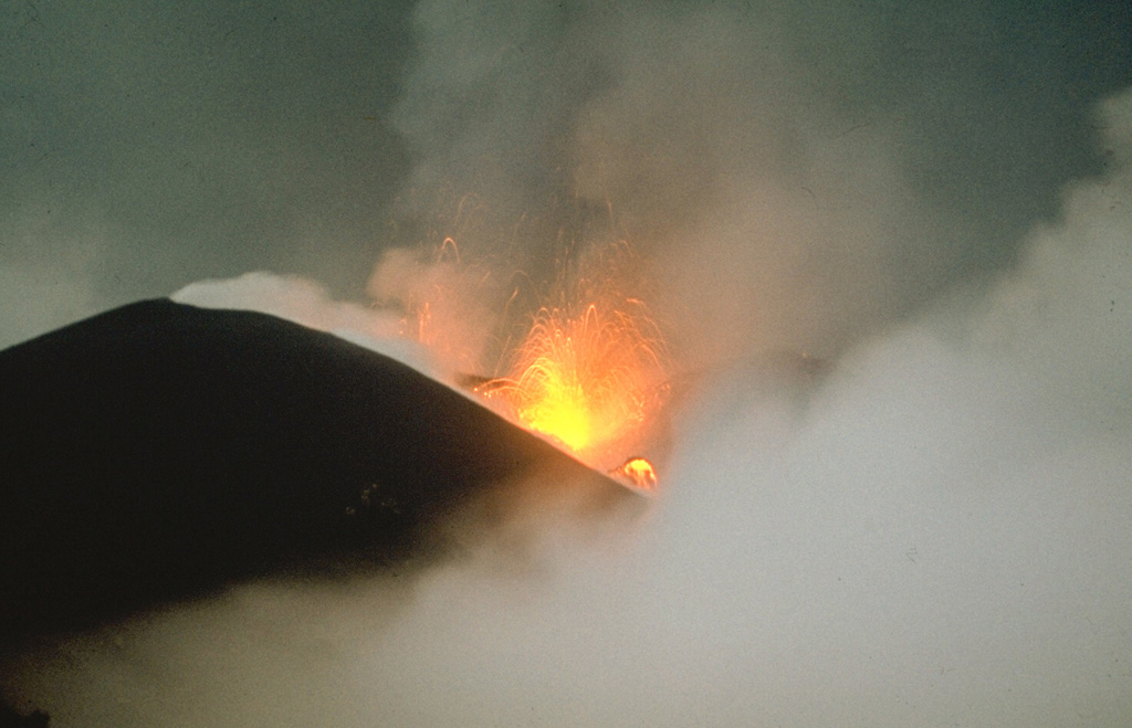 Strombolian eruptions occurred at vents along a 2-km-long fissure on the NW flank of Alaid in 1972. Explosive activity began on 18 June and was accompanied by lava extrusion beginning on the 21st. By 16 July lava flows dominated the activity, extending 1 km to the sea and forming a new peninsula. Explosive activity diminished prior to the end of the eruption on 11 September.  Photo by A.M. Chirkov, 1972 (courtesy of Oleg Volynets, Institute of Volcanology, Petropavlovsk).