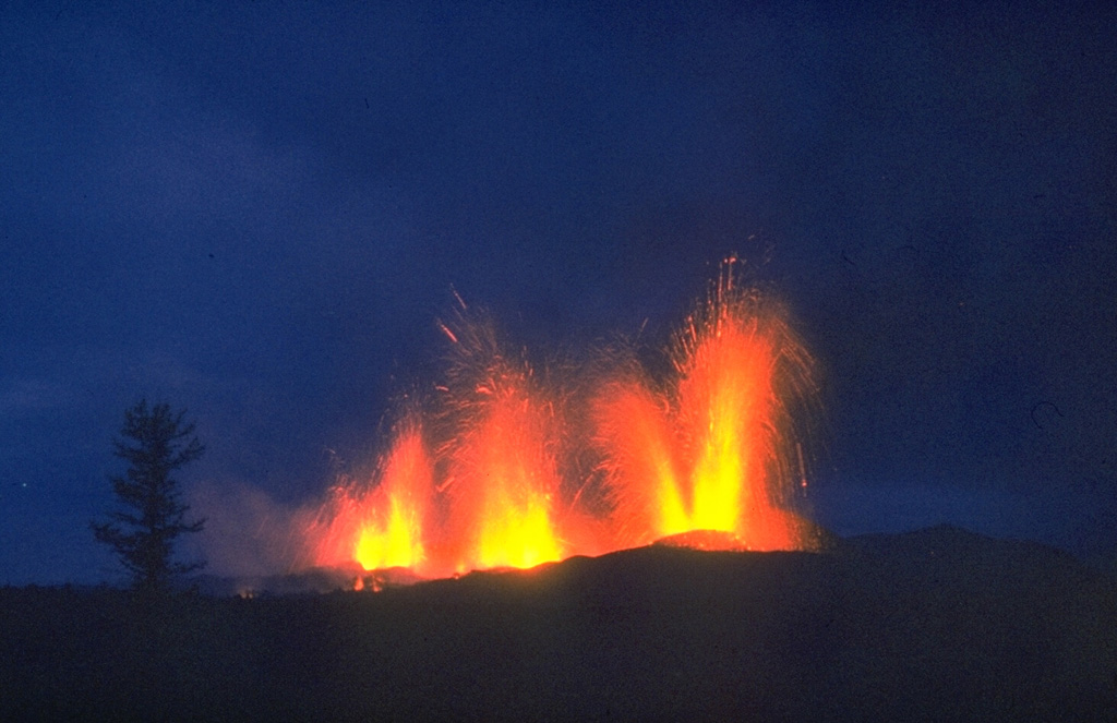 Lava fountains erupt on 20 September 1975, two days after the continuation of activity 10 km south of the earlier activity at the northern end of the Tolbachik eruptive fissure. Activity at the southern end was dominantly effusive, and lasted 15 months, much longer than the three-month-long activity at the northern end. Photo by Oleg Volynets, 1975 (Institute of Volcanology, Petropavlovsk).