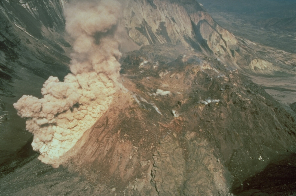 An ash plume rises above a rockfall on the south side of the Mount St. Helens dome during a period of lava dome growth in June 1985. Lava dome growth occurred intermittently from 1980 to 1986. Photo by Gene Iwatsubo, 1985 (U.S. Geological Survey).