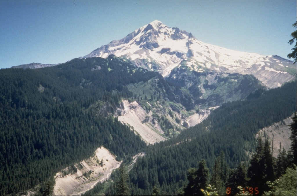 The upper Sandy River valley on the SW side of Mount Hood has been one of the primary channels for lahars associated with eruptions during the past 1800 years.  These late-stage eruptions originated from vents high on the SW flank of the volcano. Photo by Willie Scott, 1995 (U.S. Geological Survey).