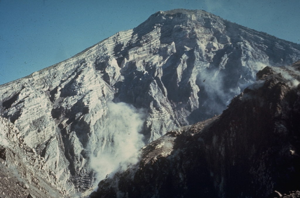 The interior of a stratovolcano is dramatically revealed in a 1-km-wide crater created on the SW flank of Guatemala's Santa María volcano during an eruption in 1902. The 1,200-m-high scarp exposes thin, light-colored lava flows that are interbedded with deposits of fragmented rock produced during growth of the volcano. The 1902 eruption was one of the world's largest during the 20th century. Copyrighted photo by Dick Stoiber, 1969 (Dartmouth College).