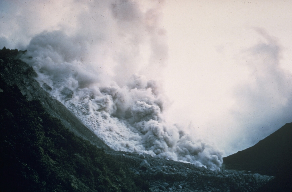 A pyroclastic flow produced by collapse of a growing lava dome descends the north flank of El Brujo vent on Santiaguito lava dome in November 1967.  Periodic larger collapses of Santiaguito have sent pyroclastic flows down the populated south flanks.  The most catastrophic of these traveled 10 km in 1929, when hundreds to thousands of people were killed.   Copyrighted photo by Dick Stoiber, 1967 (Dartmouth College).