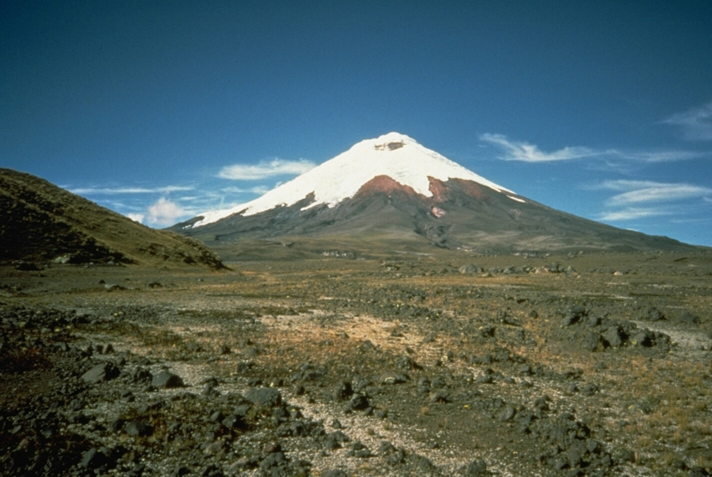 The foreground of this flat valley north of Cotopaxi volcano is the top of the deposit produced by a massive lahar from the volcano in 1877.  During this eruption, one of the largest from Cotopaxi during historical time, pyroclastic flows descended all sides of the volcano, creating devastating lahars.  The lahar that produced this deposit eventually traveled north down the Guayllabamba River past Quito to reach the Pacific Ocean at Esmeraldas, 225 km NW of Cotopaxi.  Mudflows also swept down valleys south and east into the western Amazon basin. Photo by John Ewert, 1987 (U.S. Geological Survey).