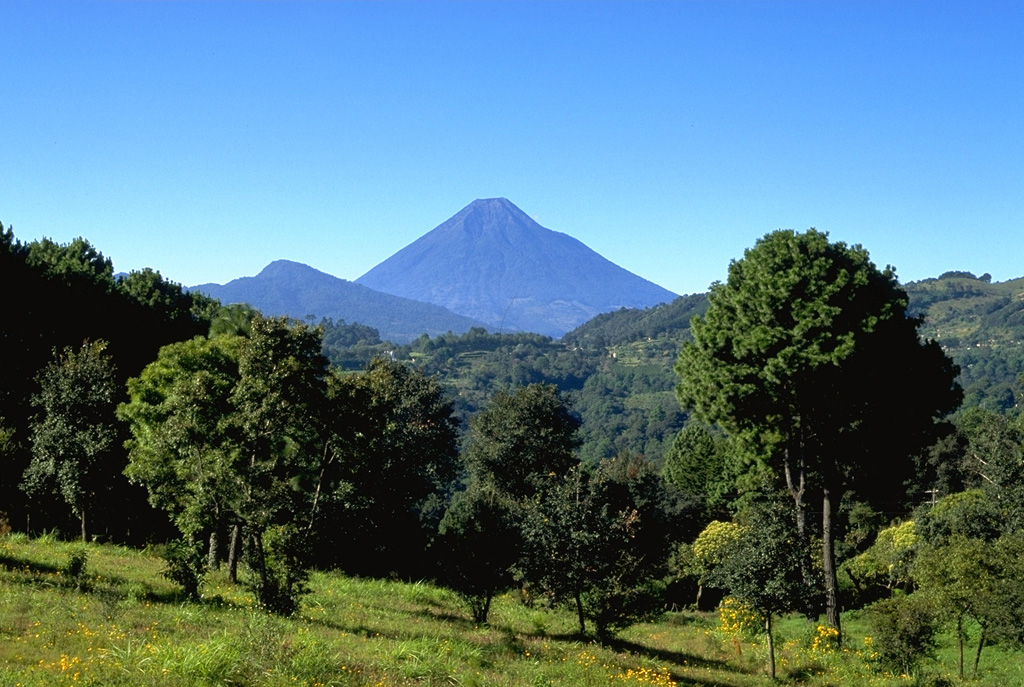 Conical Volcán de Agua is one of Guatemala's most dramatic landmarks.  Its 3760-m-high summit is prominent from Guatemala City.  The summit crater of Agua is breached to the north, in the direction of this photo.  Despite its youthful profile, no historical eruptions are known from Agua. Copyrighted photo by Stephen O'Meara, 1993.
