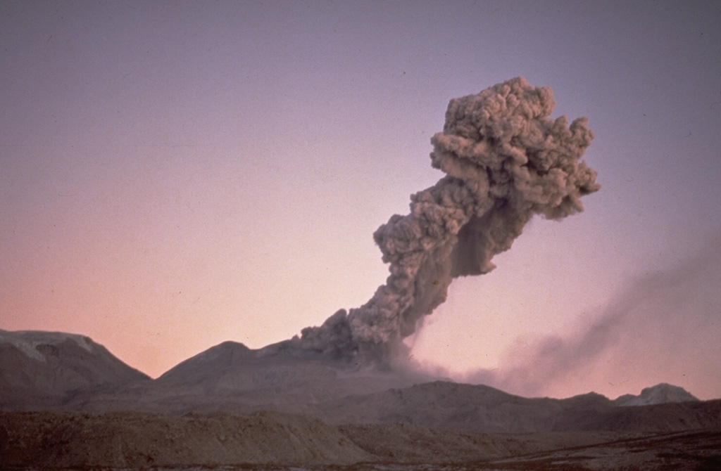 Winds deflect an eruption column from Sabancaya volcano to the NE on July 13, 1990.  Residents living near the volcano reported an explosive eruption from Sabancaya that began on May 28, 1990.  Initially, several explosions occurred per day, producing plumes to about 2 km height.  Activity intensified on June 4, and by the 8th explosions occurred at intervals of 5-10 minutes and ashfall covered a radius of 20 km.  More-or-less constant ash emission continued until 1998. Photo by Guido Salas, 1990 (University of San Antonio, Arequipa).