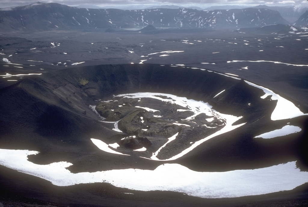 The primary 1931 eruption site is nestled against the NW wall of Aniakchak caldera. This 600-m-wide crater was the site of intermittent explosions of pumice-lithic tephra over the course of several weeks in May and June 1931. During the final phases of the eruption, a small lava flow formed in the bottom of the crater. The fissure eruption cut through Vent Mountain and across the caldera floor to the western caldera wall. Photo by Game McGimsey, 1992 (Alaska Volcano Observatory, U.S. Geological Survey).