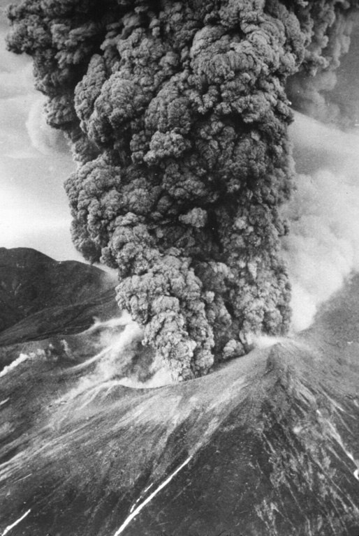 An ash plume towers above Tokachidake on 30 June 1962. A phreatic explosion on 29 June that killed five sulfur mine workers was followed by a magmatic eruption three hours later. It continued for 11 hours, producing a 12-km-high ash plume. Weak eruptions continued intermittently until September.   Photo by Asahi Shimbun, 1962 (courtesy of Mario Yoshida, Hokkaido University).