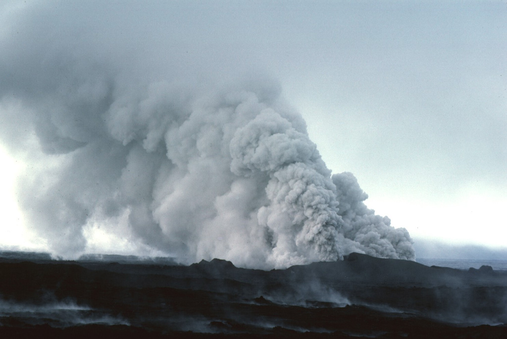 On September 13, 1984, groundwater gained access to the eruptive fissure, producing these clouds of steam and ash.  The two-week-long eruption, which began on September 4, was dominantly effusive, and produced 0.12 cu km of lava flows from an 8.5-km-long fissure. Photo by Michael Ryan, 1984 (U.S. Geological Survey).