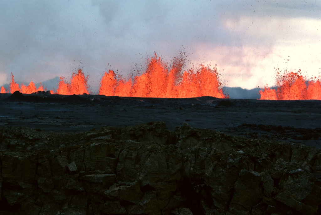 Incandescent lava fountains rise from an eruptive fissure at Krafla volcano in NE Iceland on 6 September 1984. After a quiet interval of 33 months, an eruption began on 4 September along a fissure extending from Leirhnjúkur 8.5 km N. Initially, the fissure was active along its entire length, but later lava production was highest at the northern end. Photo by Michael Ryan, 1984 (U.S. Geological Survey).