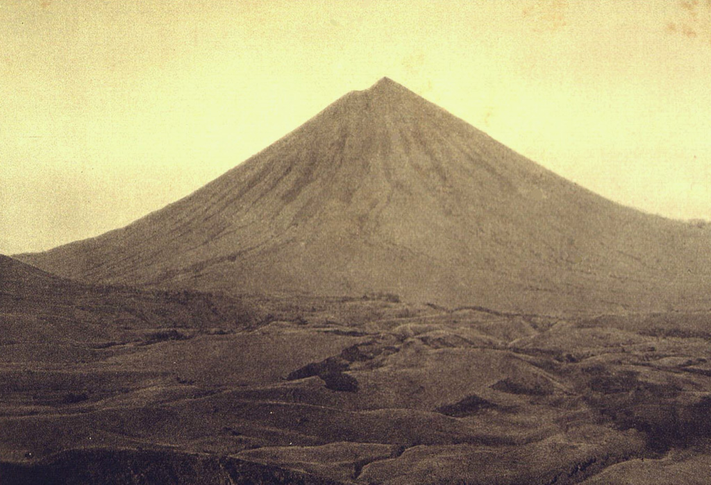 Inierie, the highest volcano on Flores Island, rises above hilly terrain of the central highlands below its northern flank. It has an elliptical crater immediately E of its summit that occasionally produces plumes. Photo by E. Weissenborn (published in Kemmerling 1929,