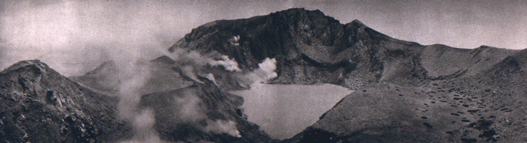 Fumaroles line the walls of the summit crater of Egon. A lake occupies the floor of the crater in this 1920's view from the southern crater rim. The northern crater rim marks the summit of the volcano. Photo published in Kemmerling 1929,