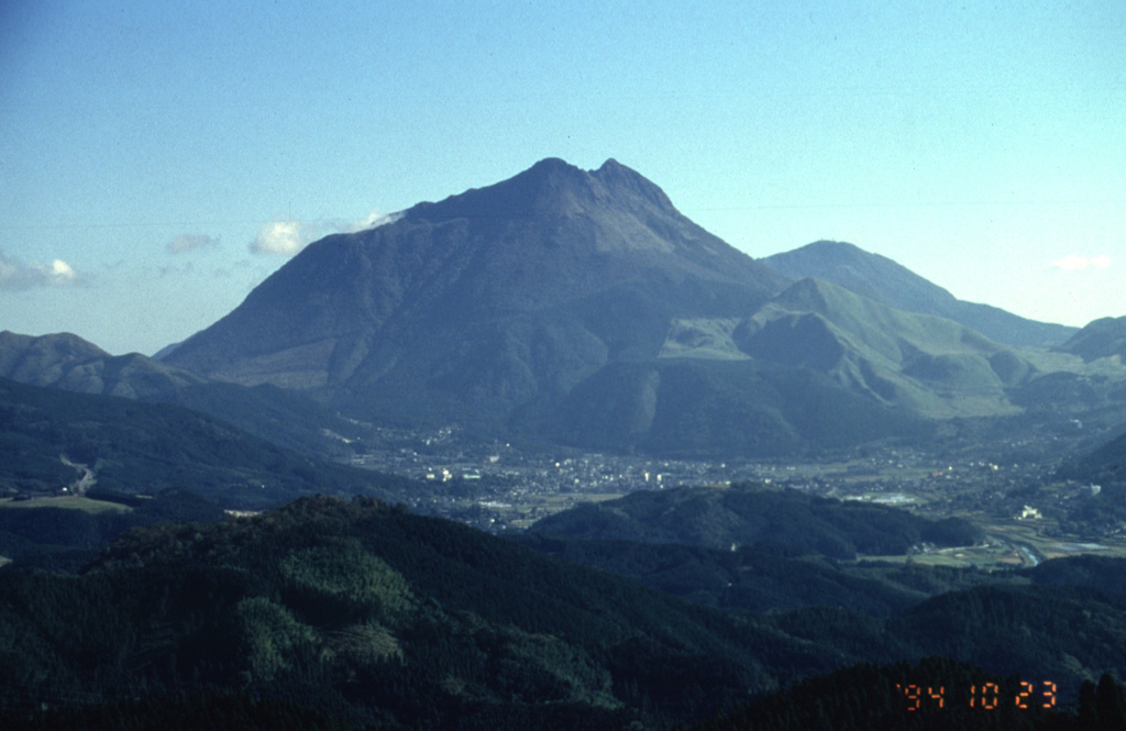 Yufudake, the westernmost of the two large lava dome complexes of Tsurumi volcano, rises to the NE of the city of Yufu in northern Kyushu. Three smaller lava domes are located on the N flank of the eastern dome. A historical eruption occurred in 867 CE.  Photo by Yukio Hayakawa, 1994 (Gunma University).