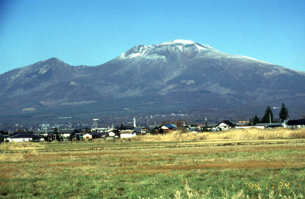 Asama, one of Honshu's most active volcano, is seen here from the SE. The snow-capped modern cone of Maekakeyama (center) was constructed within a horseshoe-shaped collapse scarp resulting from the failure of Kurofuyama, an older cone forming the lower peak to the left. The E-facing escarpment of Kurofuyama was created by a large volcanic landslide about 20,000 years ago. Maekakeyama is probably only a few thousand years old, but has had several major Plinian eruptions, the last two of which occurred in 1108 and 1783 CE. Photo by Yukio Hayakawa, 1998 (Gunma University).