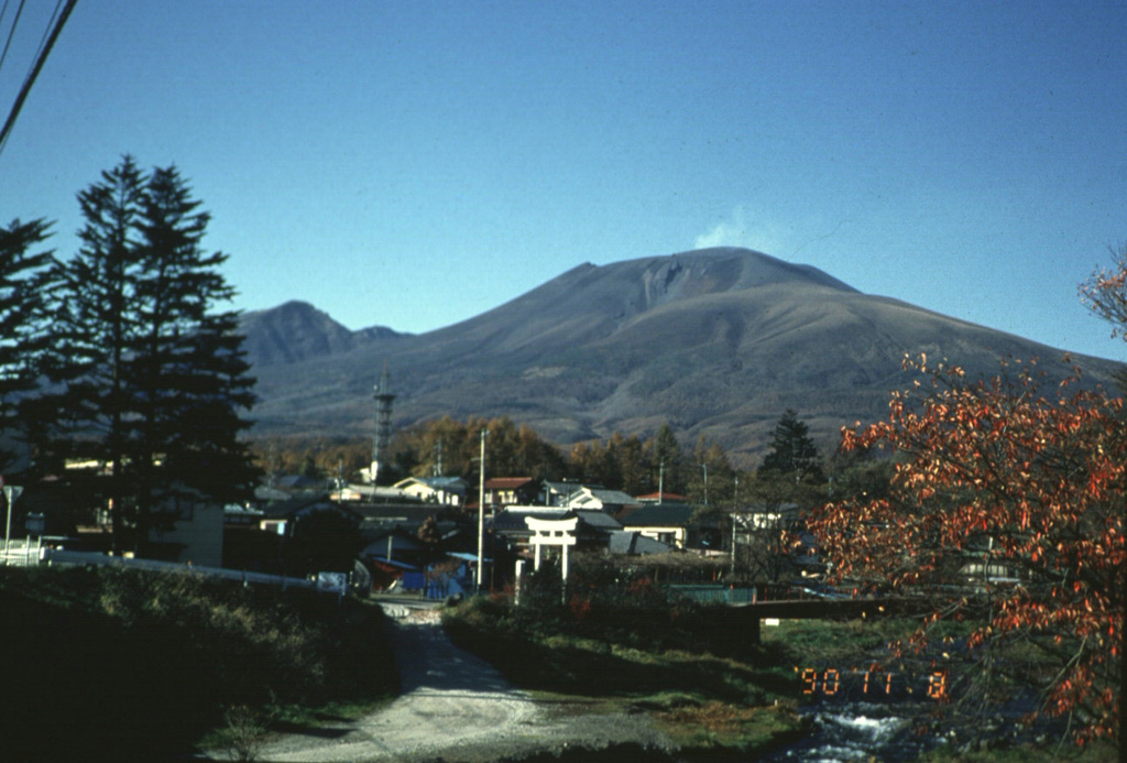 A faint plume rises above the summit of Asama behing the resort city of Karuizawa, immediately SE of the volcano. Asama is one of the most active volcanoes in Honshu and ash from its eruptions occasionally reach Tokyo. Photo by Yukio Hayakawa, 1990 (Gunma University).