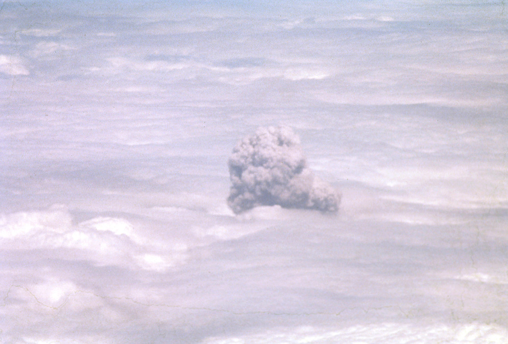 A convecting ash-bearing eruption cloud from Telica volcano punches through a low cloud layer in February 1982.  Continuous white vapor columns with occasional ash were observed beginning in late November 1982, and small gas-and-ash eruptions took place in late December and early January.  Large eruptions on February 12 and 19 sent clouds to 3.7-4.3 and 3.5 km above sea level, respectively.  Eruptive activity ended on March 2. Photo by Bill Rose, 1982 (Michigan Technological University).