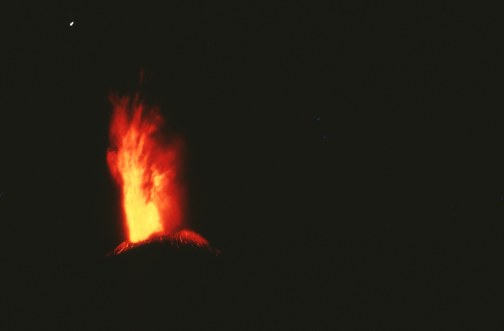An incandescent eruption column rises above the summit of Cerro Negro in 1971.  Major explosive eruptions February 3-14, primarily from the central vent, produced extensive crop damage over a 5000 sq km area and enlarged the summit crater from 150 to 400 m diameter.  Photo by Jaime Incer, 1971.