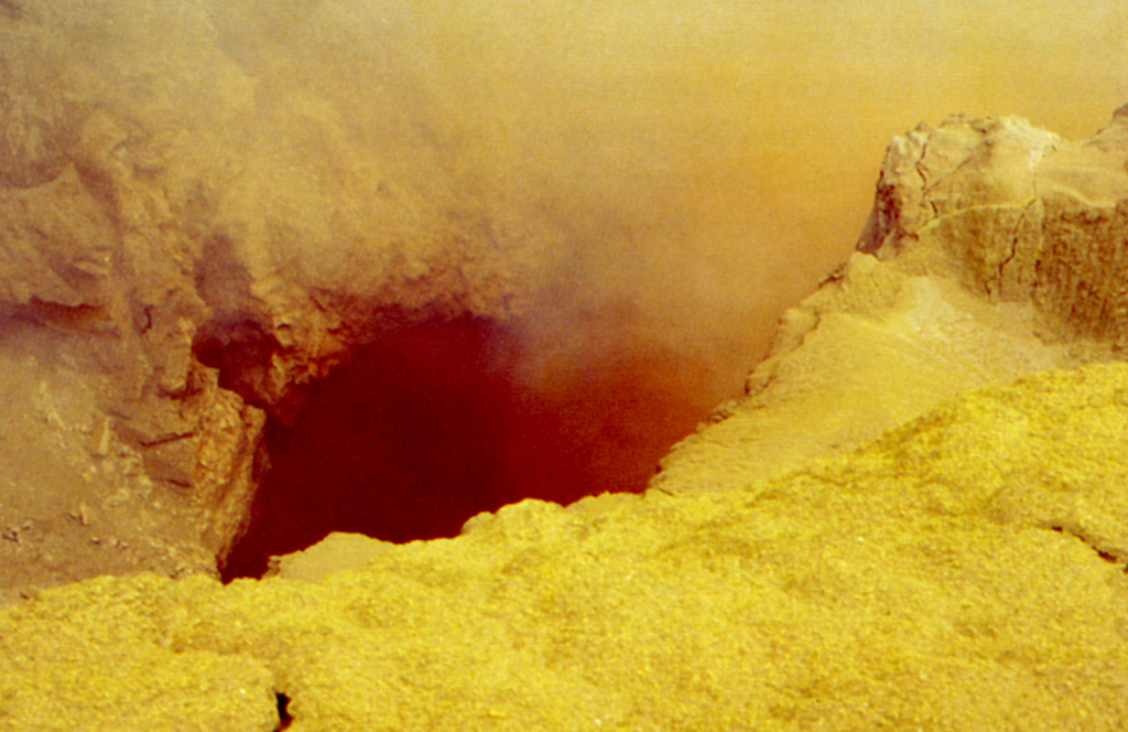 Brilliantly colored sulfur and other minerals precipitate around high-temperature fumaroles in the summit crater of Poás volcano.  Fumarolic temperatures approaching 600 degrees Centigrade were recorded in 1988, several times higher than the melting point of sulfur.  The ejection of pyroclastic material consisting of scoriaceous sulfur resembling basaltic scoria as well as the emission of small sulfur lava flows has been documented during several historical eruptions at Poás. Photo by Jorge Barquero (Universidad Nacional Costa Rica).