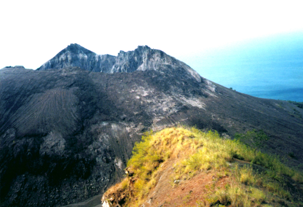 A lava dome, formed during the first historical eruption of Iliwerung volcano in 1870, occupies the summit crater of the volcano, seen here in 1979 from the rim of Ado Wajung crater.  Iliwerung forms one of the south-facing peninsulas on Lembata (formerly Lomblen) Island, and has a series of lava domes and craters along N-S and NW-SE lines.  Many of these vents, including submarine vents offshore, have erupted in historical time. Photo by Volcanological Survey of Indonesia.