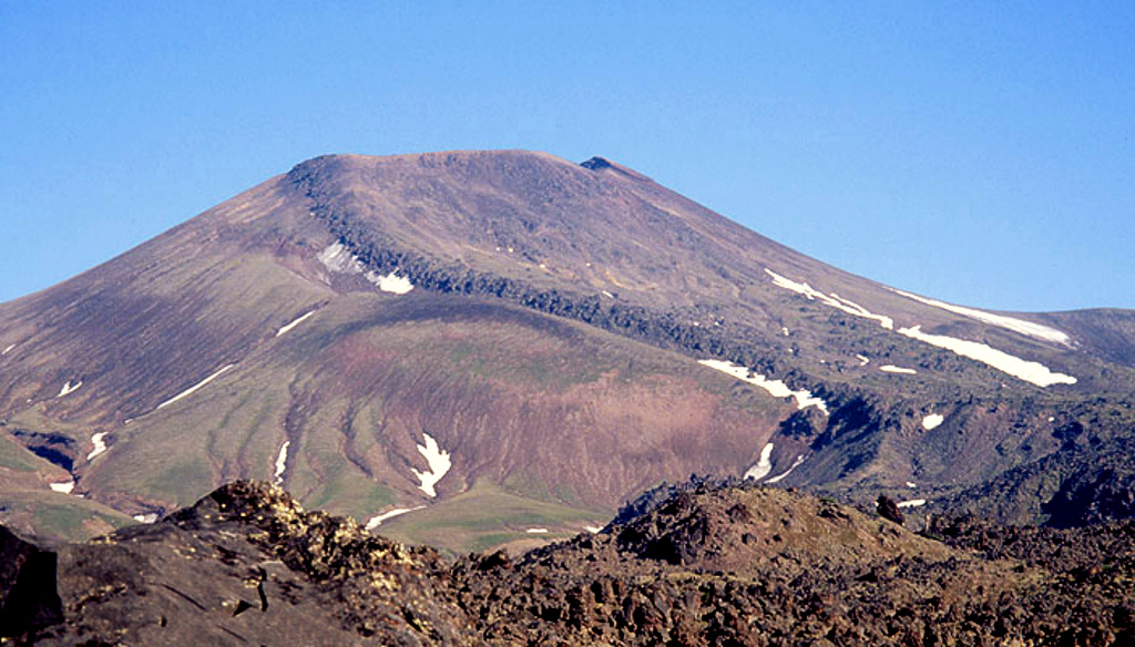 A broad lava flow descends from the summit crater down the southern flank of Vysoky, which is located about 4 km NE of Komarov. It has been active from the beginning of the Holocene and the lava flow was produced at least about 2,000 radiocarbon years ago. Copyrighted photo by Vera Ponomareva (Holocene Kamchataka volcanoes; http://www.kscnet.ru/ivs/volcanoes/holocene/main/main.htm).