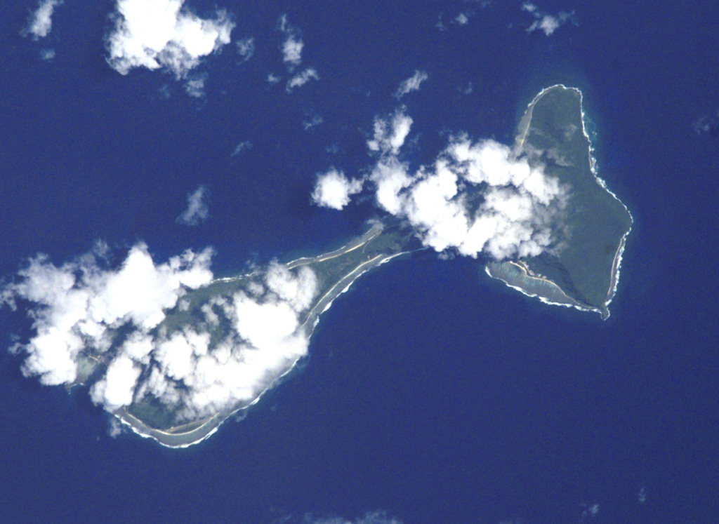 Clouds drape the tops of the two islands of Ofu (left) and Olosega (right) in eastern Samoa in this Space Shuttle image (N is to the top left). The islands, 6 km in combined length, are separated by a narrow strait. They are formed by two eroded, coalescing basaltic shield volcanoes truncated by mostly-submarine calderas. A submarine eruption took place in 1866 about 3 km SE of Olosega, along the ridge connecting Olosega with Ta'u Island. NASA Space Shuttle image ISS002-E-6878, 2001 (http://eol.jsc.nasa.gov/).