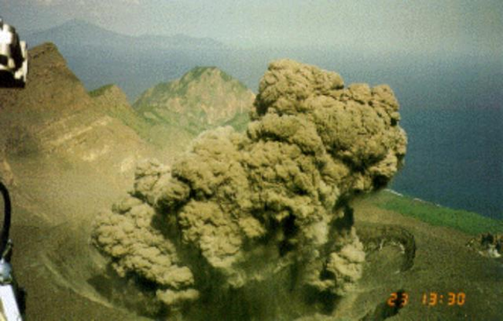 An ash plume rising above the summit crater of Suwanosejima is photographed from a helicopter on 12 May 2001. Eruptions on the evening of 12 May and the morning of the 13th deposited up to 3 cm of ash in Toshima village, about 4 km NNW of the crater. After a quiet period of about 10 months eruptive activity had resumed on 19 December 2000 and continued intermittently until July 2004. Photo courtesy of Japan Meteorological Agency, 2001.