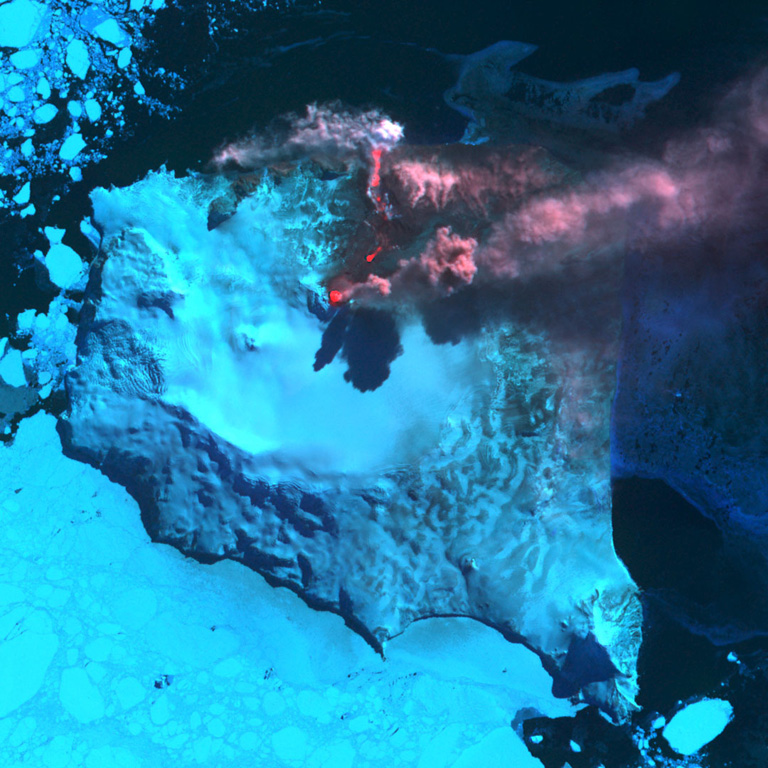 A NASA image shows Montagu Island's Mount Belinda in the South Sandwich Islands in eruption on September 23, 2005.  A reddish dot (center) marks a thermal anomaly over the active summit vent.  An ash plume rising above the summit cone casts a shadow on the glacier and is blown eastward by prevailing winds.  The reddish area extending to the north coast of the island is a lava flow that produces steam clouds where it enters the sea.  The eruption was first detected by satellite thermal alerts in October 2001.  Sea ice partially surrounds the island. ASTER satellite image courtesy of Hawaii Institute of Geophysics and Planetology (HIGP) Thermal Alerts Team, 2005.