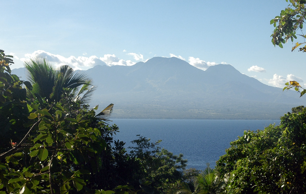 The broad Cuernos de Negros volcanic complex is seen here from the small island of Apo, 7 km SE of the city of Zamboanguita at the southern end of Negros Island. The eastern side of the complex consists of two cones and a lava dome with two crater lakes up to 1.5 km in diameter. The small summit crater of Magaso, the highest peak of the complex, rises above the city of Dumaguete and contains fumaroles. The Palinpinon geothermal field is located on the north side of the volcano. Photo by Arne Kuilman, 2007.