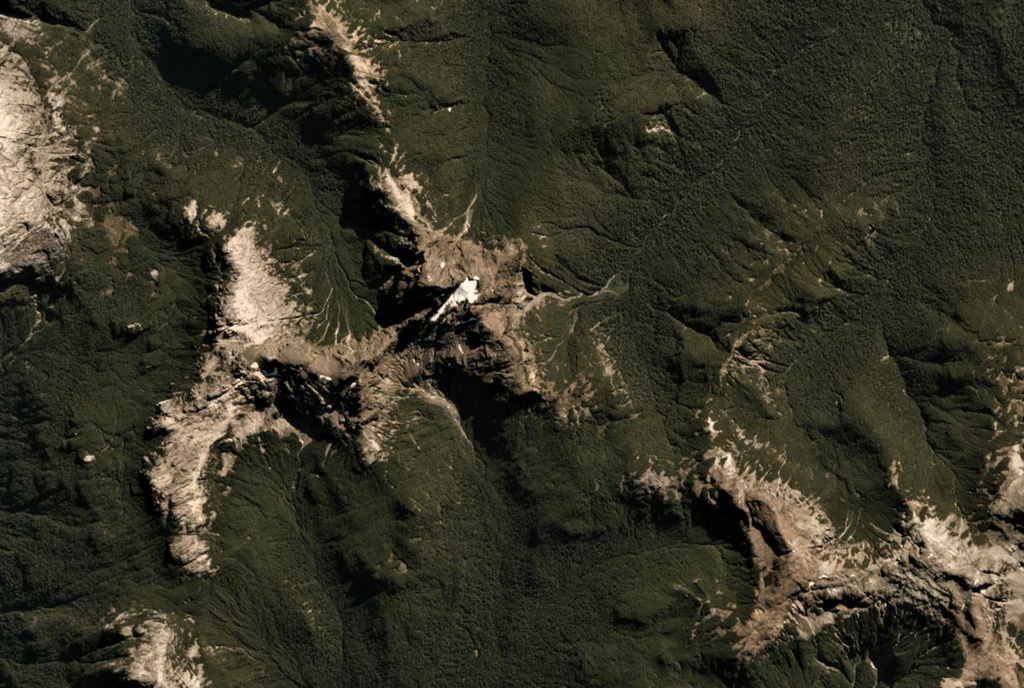 Cuernos del Diablo is a small glacially eroded edifice in Chile, seen here in this 26 March 2019 Planet Scope satellite image (N is at the top; this image is approximately 9.5 km across). The volcano formed numerous smaller cones and lava flows during the Holocene. Satellite image courtesy of Planet Labs, 2019.
