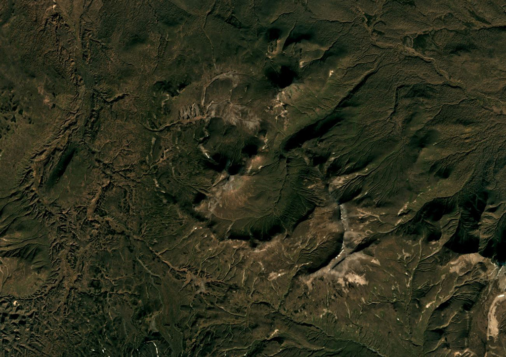 Kell volcano formed within three nested 2-5-km-wide Pleistocene calderas shown in this October 2018 Planet Labs satellite image monthly mosaic (N is at the top; this image is approximately 15 km across). The edifice is composed of several lava domes and cones. Satellite image courtesy of Planet Labs, 2018.